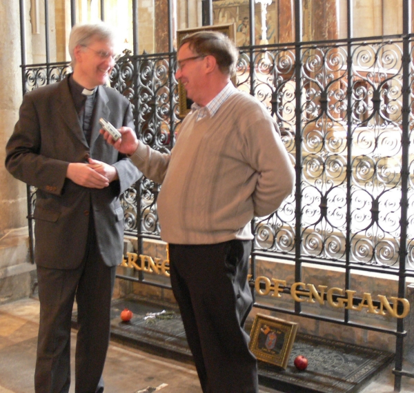 Canon Jonathan Baker talking to John Keily at Katharine of Aragon's tomb.