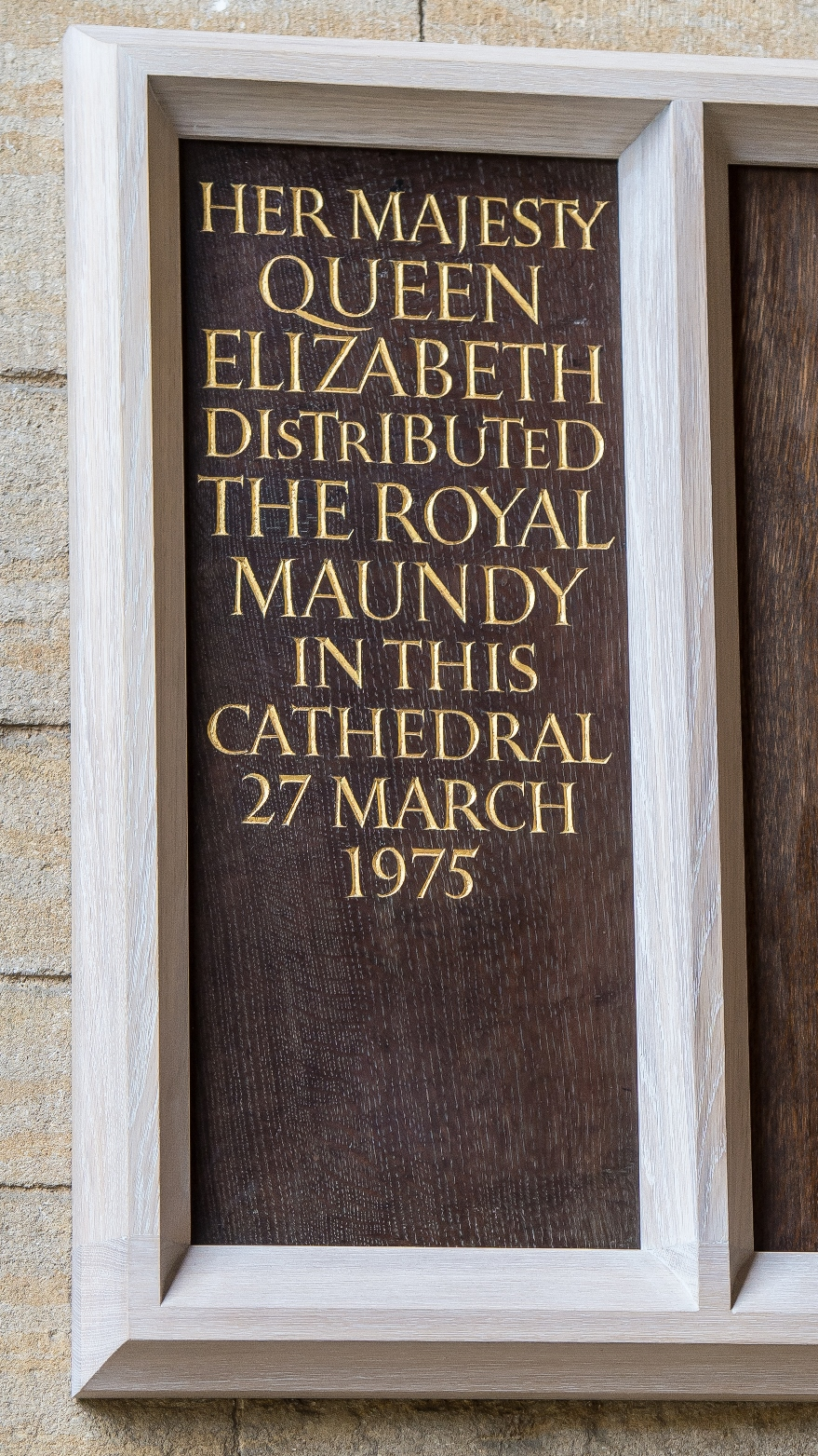 A plaque commemorating Queen Elizabeth II giving the Maundy Money at Peterborough Cathedral, 1975