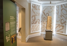 A view of the exhibition showing a 1000 year old stone carving
