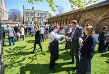 A drinks receptiojn taking place in Peterborough Cathedral Cloisters