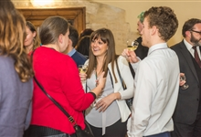 People chatting at a reception in the Knights' Chamber. Photo: Athene Communications