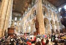 Children seated in the Nave Crossing at a Katharine of Aragon Festival event