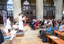 A lecture taking place in the North Transept of Peterborough Cathedral