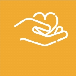 Hand holding heart shape on yellow background