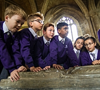 Children looking at stonework in the Cathedral